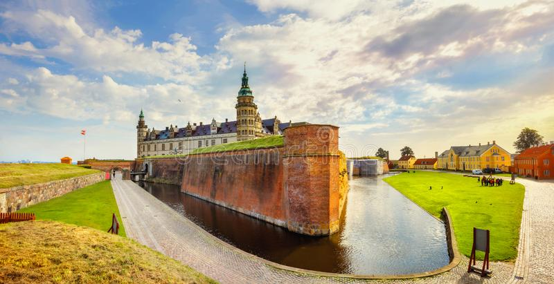 Fortifications with water canal and walls of fortress in Kronborg castle Castle of Hamlet. Helsingor, Denmark. Panoramic view of Kronborg castle with water canal royalty free stock image