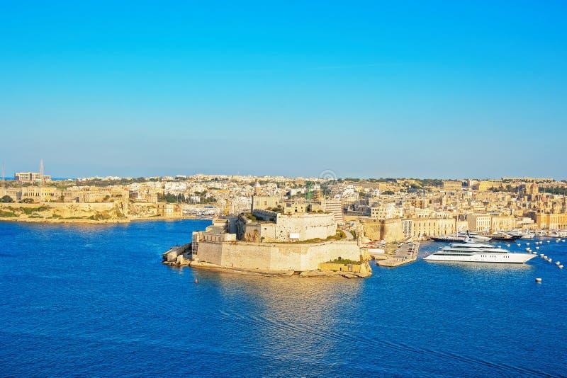Fortificazione della st Angelo di Birgu al grande porto La Valletta Malta fotografia stock libera da diritti