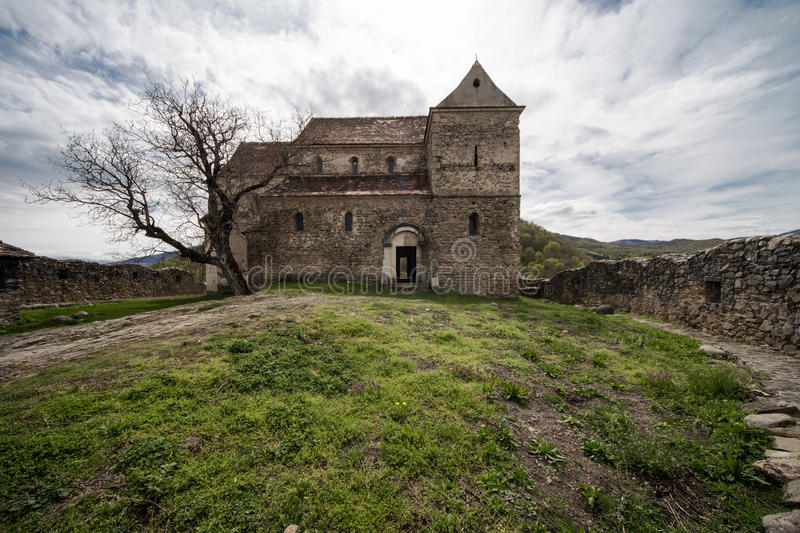 Fortified Church in Cisnadioara. Image showing a red SUV on a mountain road in Romania, owner is trying to fix the car royalty free stock images