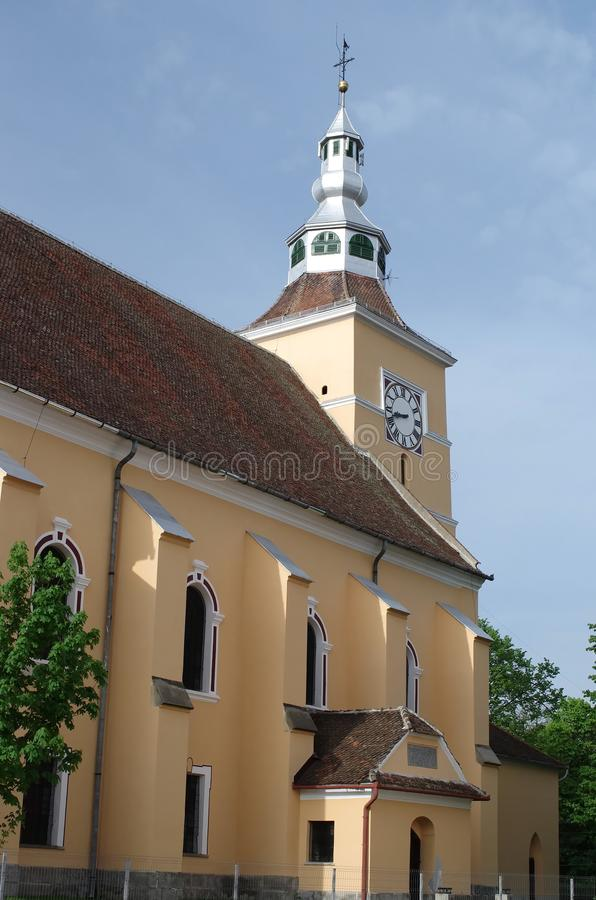 Fortified church of Halchiu - heldsdorf. The evangelical church in Halchiu it was built in the 13th century. In the church is found the largest medieval altar in stock photo