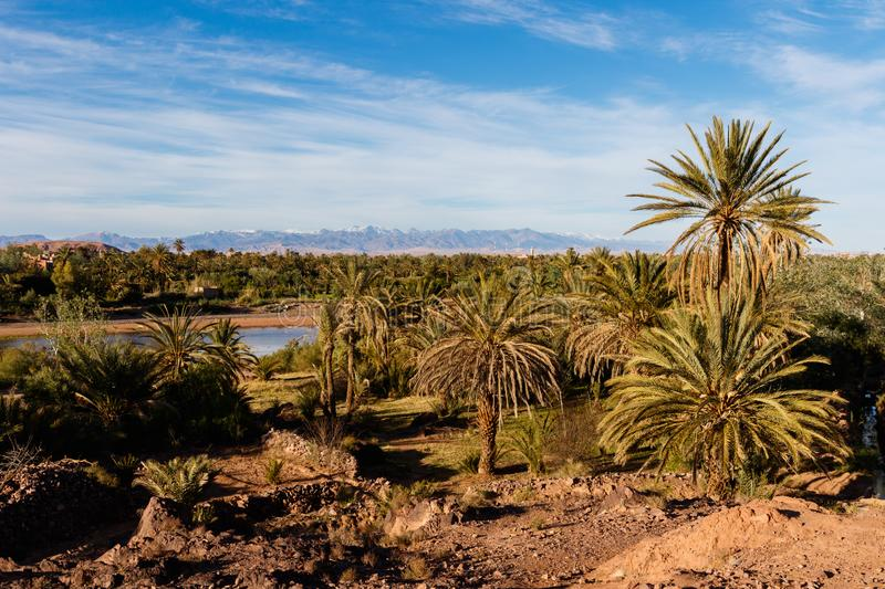Fortified city of Ait Benhaddou along the former caravan route between the Sahara and Marrakech in Morocco with snow covered Atlas royalty free stock photography
