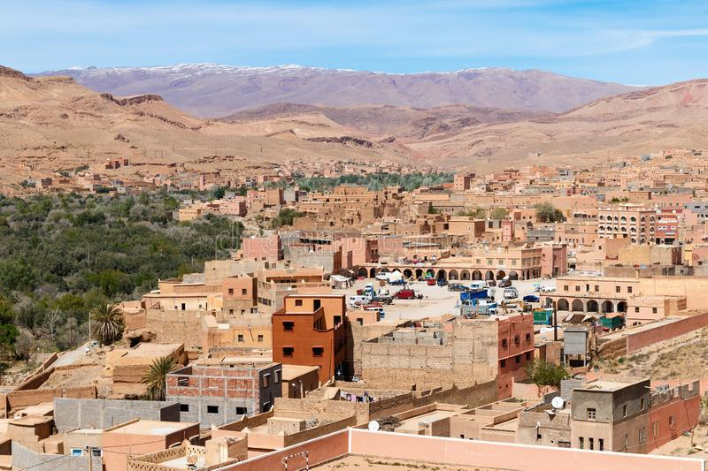 Fortified city of Tinghir along the former caravan route between the Sahara and Marrakech in Morocco with snow covered Atlas stock photos