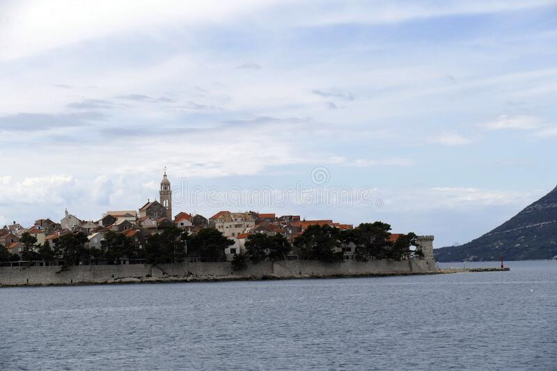 Fortified old town of Korcula. Fortified town of Korcula, approached from the Adriatic Sea,   Croatia royalty free stock photo