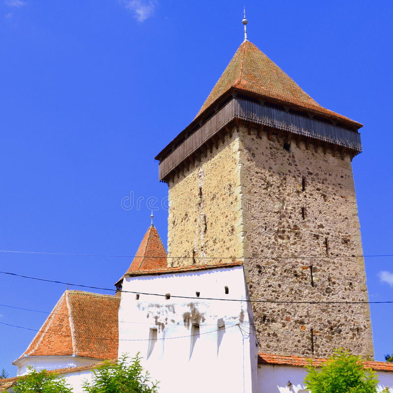 Fortified saxon medieval church Homorod, Transylvania. The villagers started building a single-nave Romanesque church, which is uncommon for a Saxon church, in stock photos