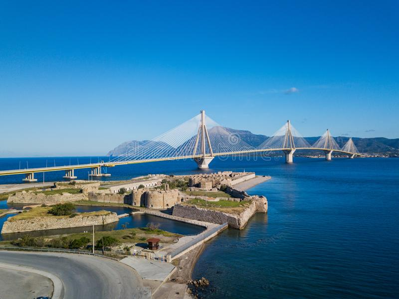 Fortress and bridge of Rio Antirio, Patra, Greece. Aerial drone bird`s eye view photo. Fortress and bridge of Rio Antirio, Patra, Peloponnese, Greece. Aerial royalty free stock photography