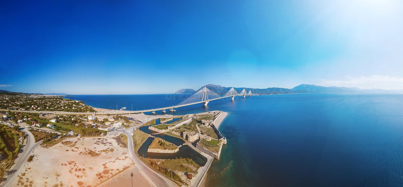 Fortress and bridge of Rio Antirio, Patra, Greece. Aerial drone bird`s eye view photo. Fortress and bridge of Rio Antirio, Patra, Peloponnese, Greece. Aerial royalty free stock photos
