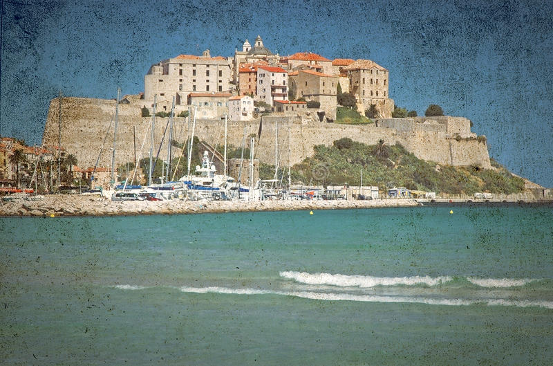 The fortress of Calvi, Corsica on a vintage postcard stock photo