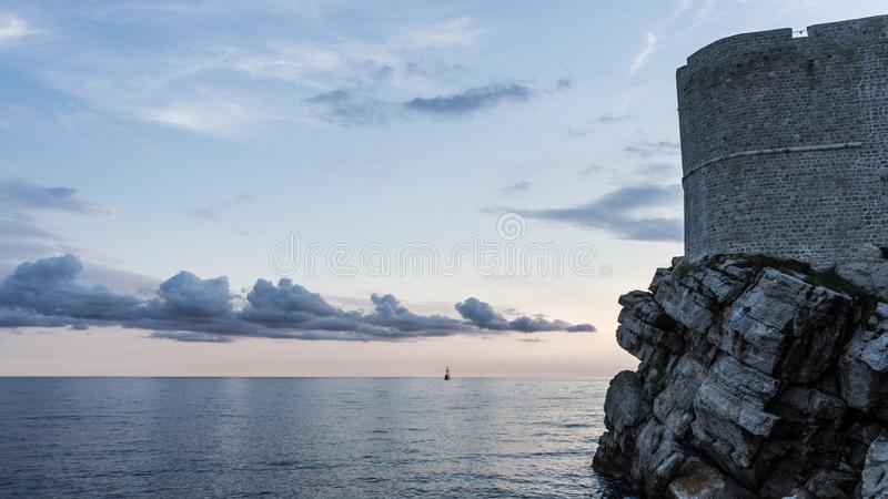 Fortress in Dubrovnik. Adriatic sea in the sunset with stone old building. Castle, croatia, architecture, medieval, post, tourism, tower, wall, safe, history royalty free stock photo