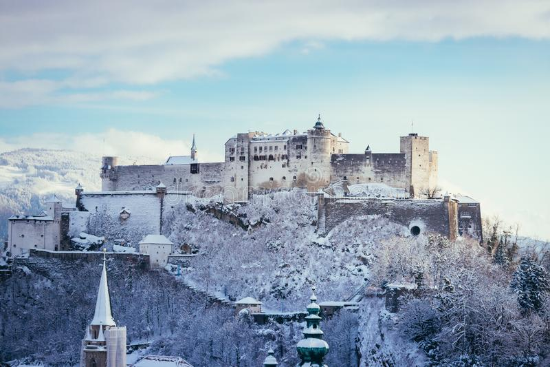 Fortress Hohensalzburg in the Winter, snowy. Landmark tourism europe travel frost landscape vacation medieval magic historic old panorama architecture blue sky royalty free stock image