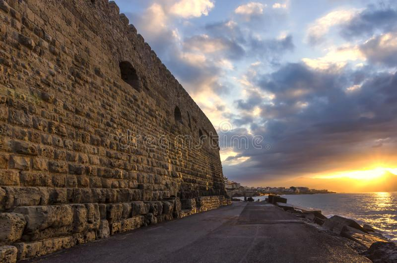 Beautiful sunset  with colorful cloudy sky at the old Venetian port in Heraklion city stock photo