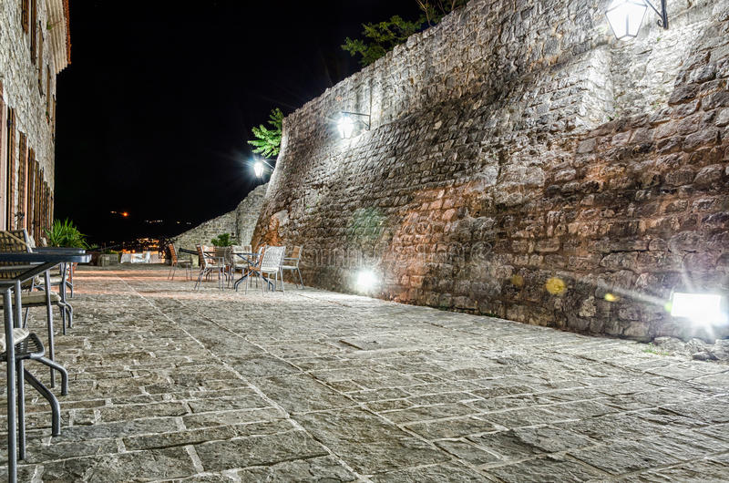 Fortress of old town Budva at night. Restaurant on fortress of old town Budva at night stock photography