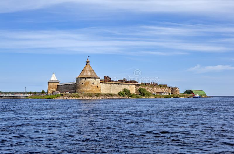 Fortress Oreshek. View from the water. Shlisselburg. Russia. SHLISSELBURG, RUSSIA - JULY 21, 2019: Stone fortress with towers and a fortress wall on the island royalty free stock photography