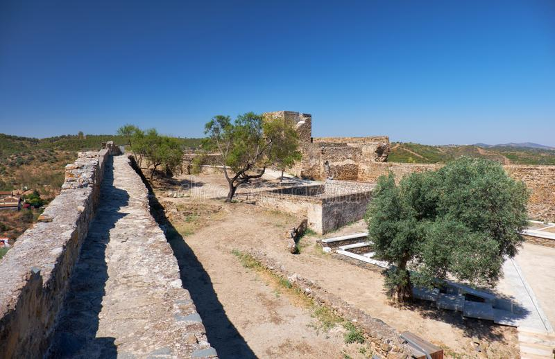 Fortress wall and inner courtyard of the Mertola Castle. Mertola. Portugal stock photo
