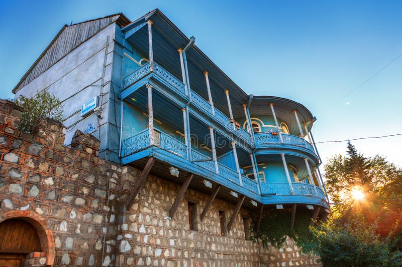 The fortress wall in old Tbilisi and the old mansion, decorated with carved balconies in Konka district, Georgia royalty free stock images