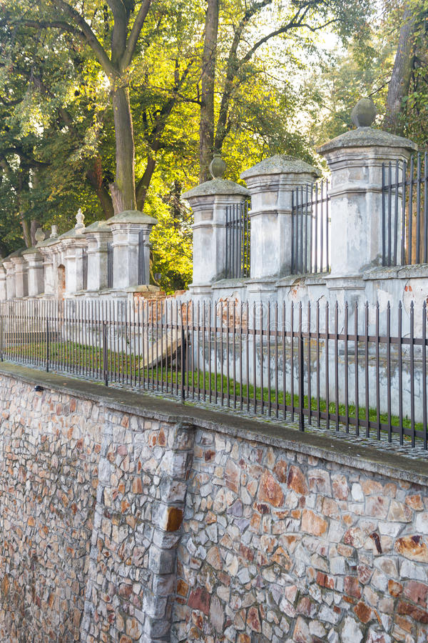 Fortress wall in old town European city. Fortress wall with trees in old town European city. Twelfth century Opatów church bastion building stock photography