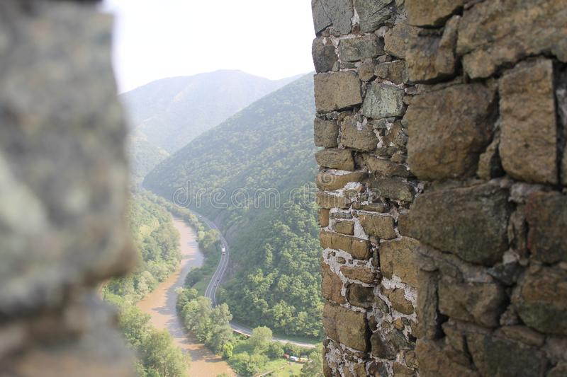 Through the fortress walls Maglic. The fortress consist of seven towers and one dungeon tower connected with walls. The towers are typical for a medieval royalty free stock images