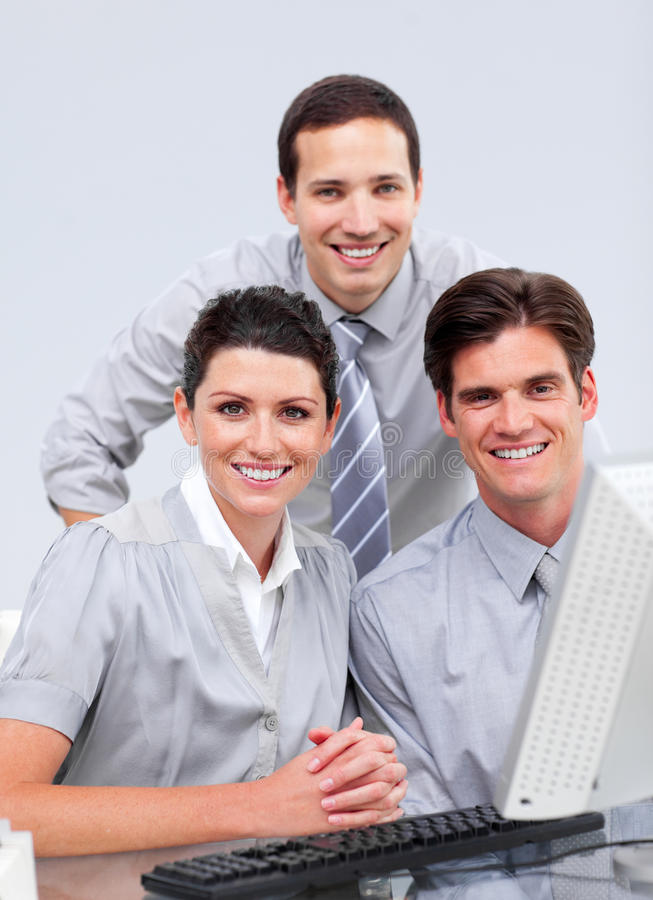 Download Fortunate Businessteam Working At A Computer Stock Image - Image: 12976079