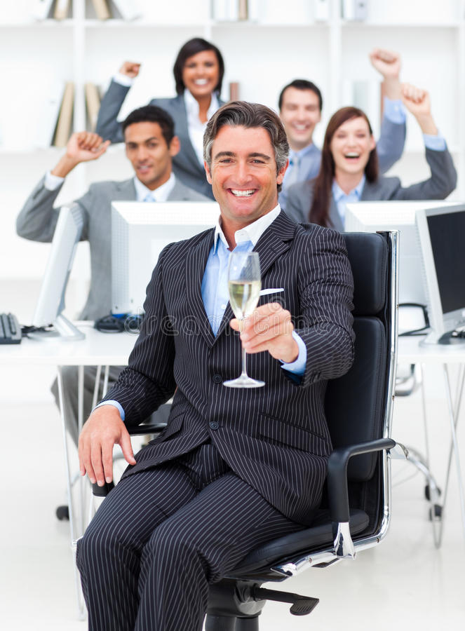 Fortunate manager and his team drinking champagne royalty free stock image