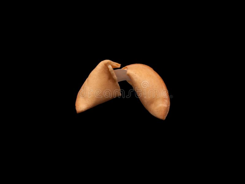 A fortune cookie on black background royalty free stock photography