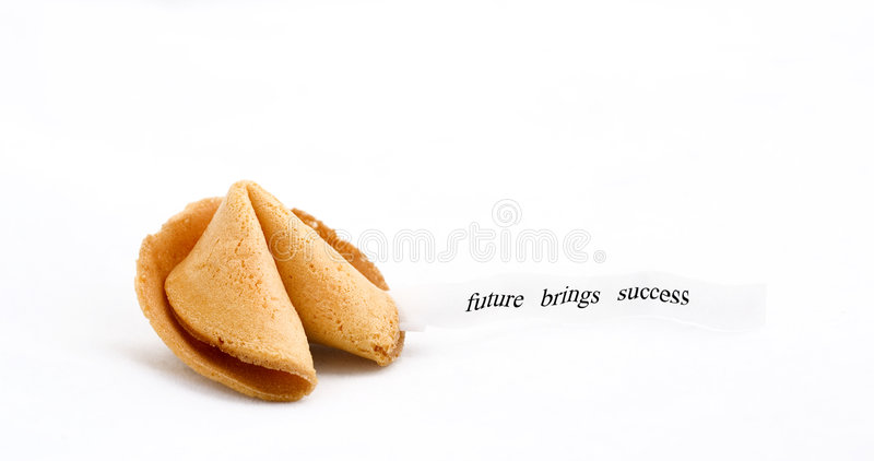 Fortune cookie saying future brings success. Fortune cookie with text saing :future brings success royalty free stock photos