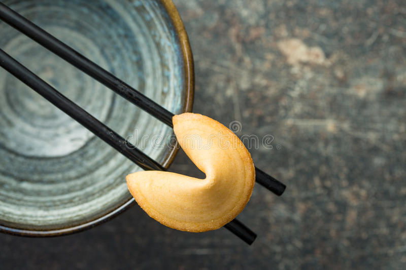 The fortune cookies. The fortune cookies on chopsticks. Top view stock photography