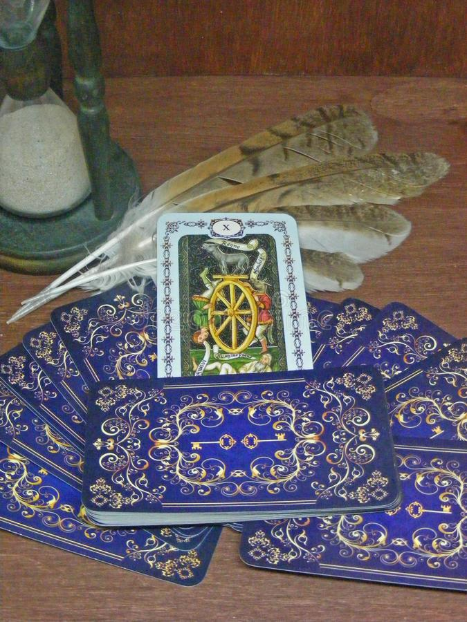 Fortune Tarot cards with wild owl feathers and hourglass stock images