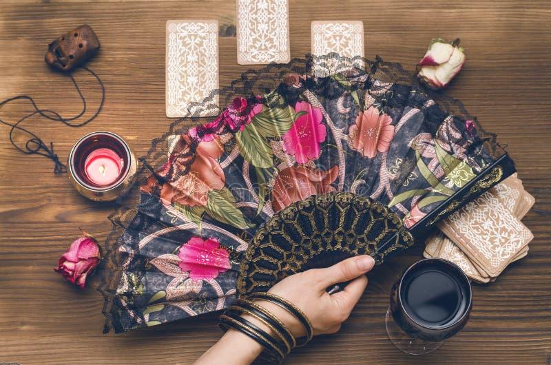 Tarot cards. Future reading. Fortune teller concept. Fortune teller female hand and tarot cards on wooden table. Fortune teller divination stock photo