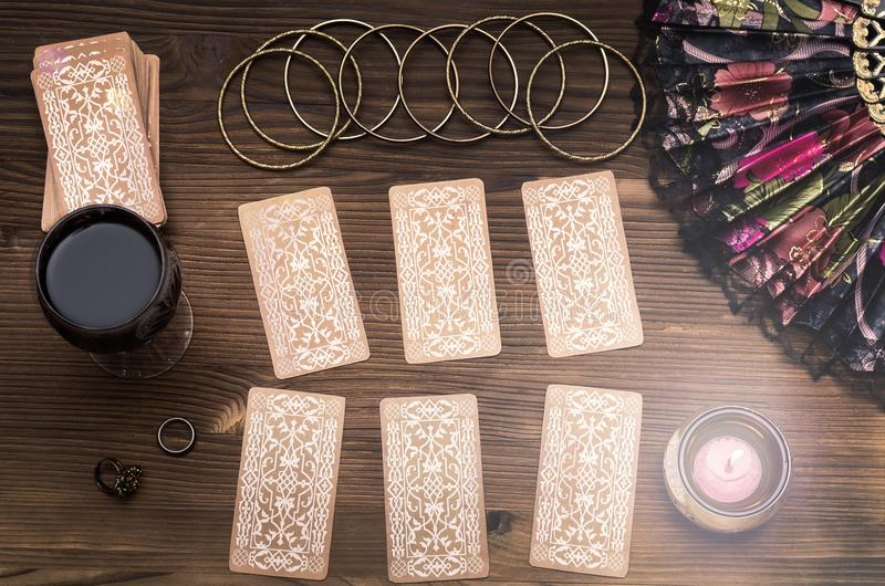 Tarot cards. Future reading. Fortune teller concept. Fortune teller female hands, talismans and tarot cards on wooden table. Fortune teller concept. Divination stock photos