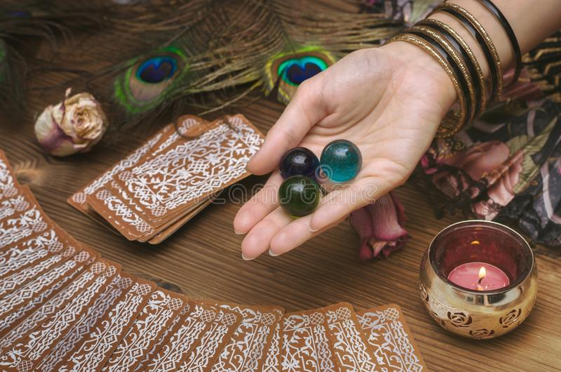 Tarot cards. Future reading. Fortune teller concept. Fortune teller female hands and tarot cards on wooden table. Divination concept royalty free stock photos