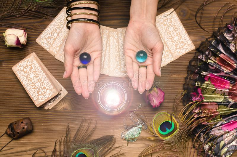 Tarot cards. Future reading. Fortune teller concept. Fortune teller female hands and tarot cards on wooden table. Divination concept stock photography