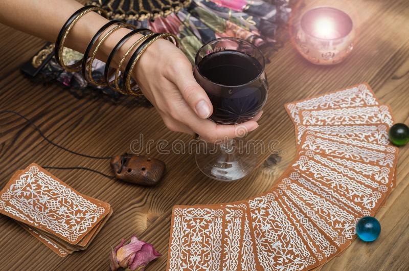 Tarot cards. Future reading. Fortune teller concept. Fortune teller female hands and tarot cards on wooden table. Divination concept stock photos