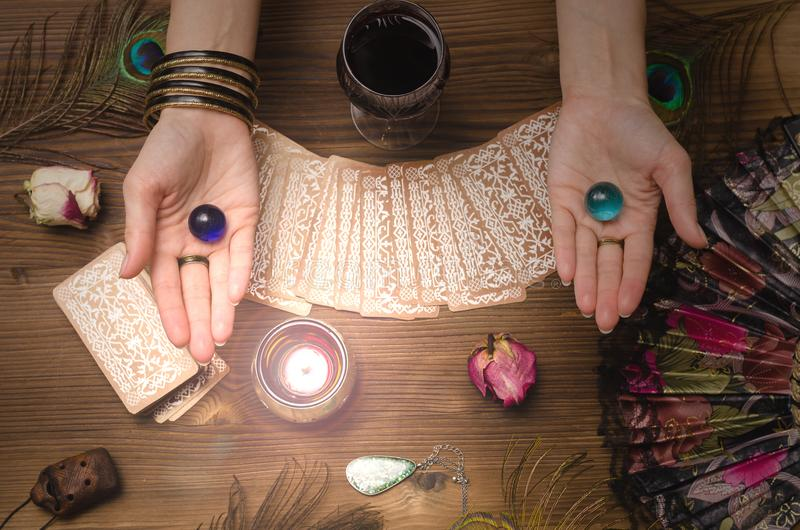 Tarot cards. Future reading. Fortune teller concept. Fortune teller female hands and tarot cards on wooden table. Divination concept royalty free stock photo