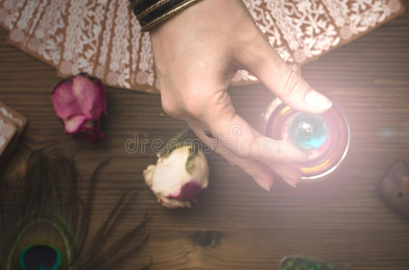 Tarot cards. Future reading. Fortune teller concept. Fortune teller female hands and tarot cards on wooden table. Divination concept stock photo