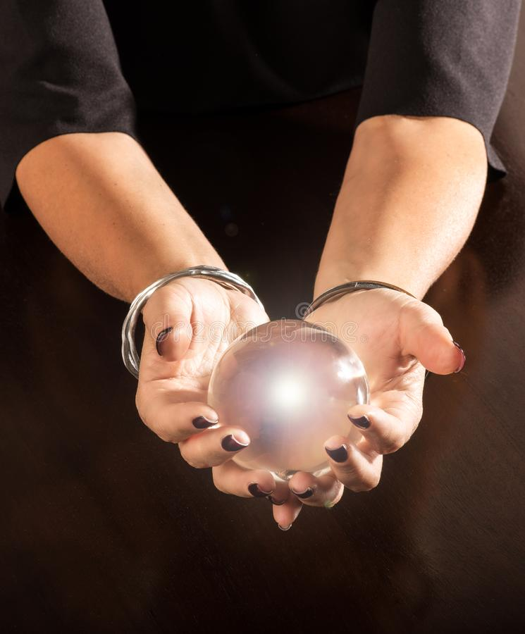 Fortune teller holding a crystal ball in her hands stock image