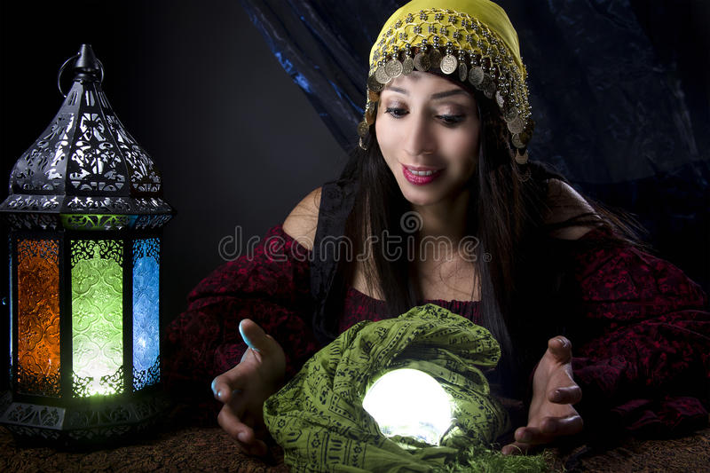 Fortune Teller Looking at Crystal Ball stock photography