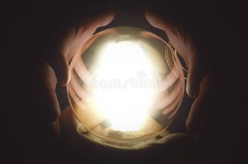 Crystall ball. Fortune teller reading future with crystal ball. Seance concept stock photography