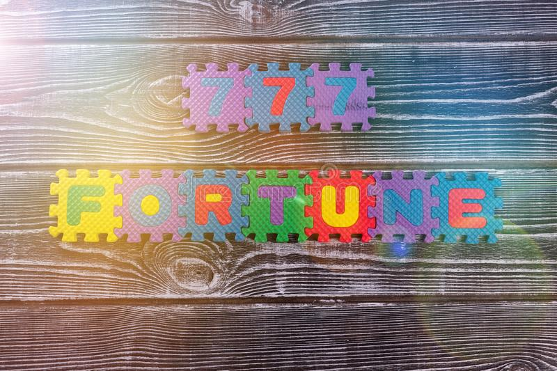 777, fortune on a wooden background. royalty free stock image