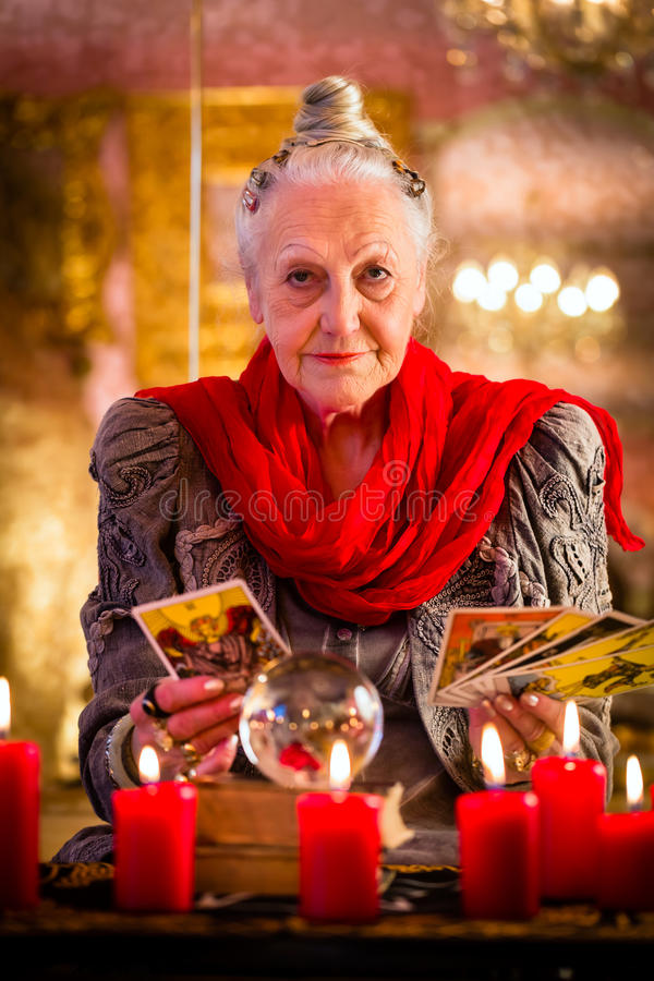 Fortuneteller during Session with tarot cards stock photos