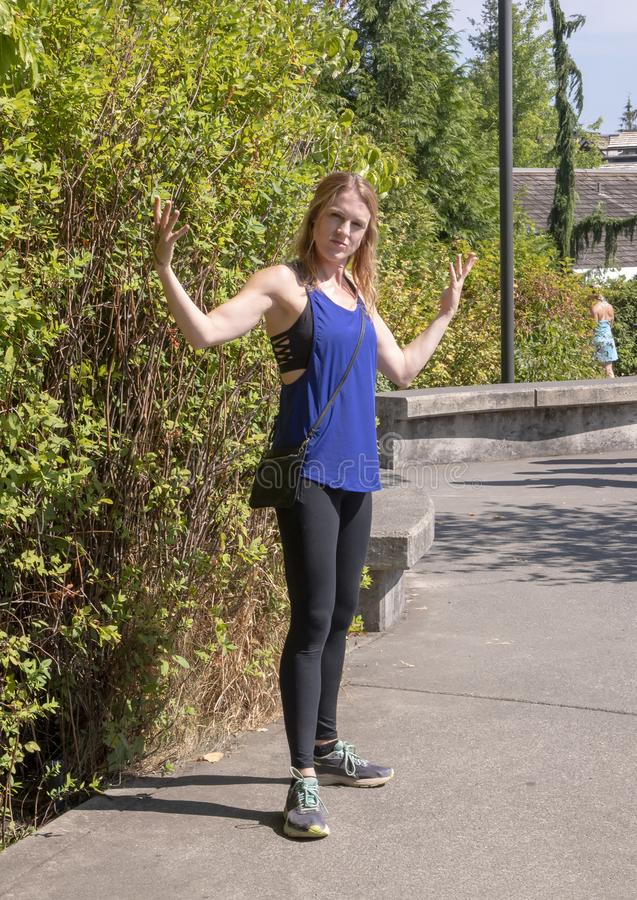 Forty-Five year old athletic woman posing in Snoqualmie Park, east of Seattle. Pictured is a 45 year-old athletic redheaded Caucasian woman posing in Snoqualmie stock photos