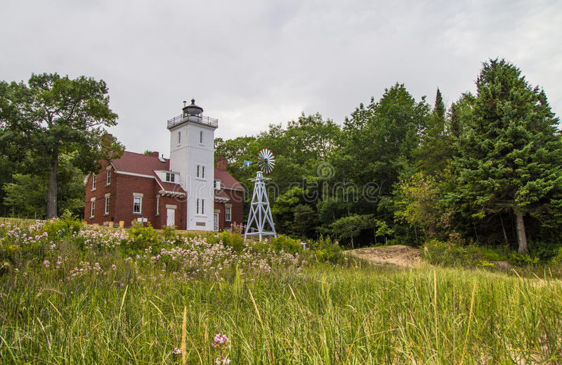 Forty Mile Point Lighthouse. The Forty Mile Point Lighthouse was completed in 1896 and is on the Lake Huron coast. The light is owned by Presque Isle County and stock photos