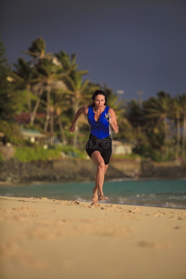 Download Forty Year Old Female Triathlete Running Stock Image - Image of triathlete, hawaii: 14074693