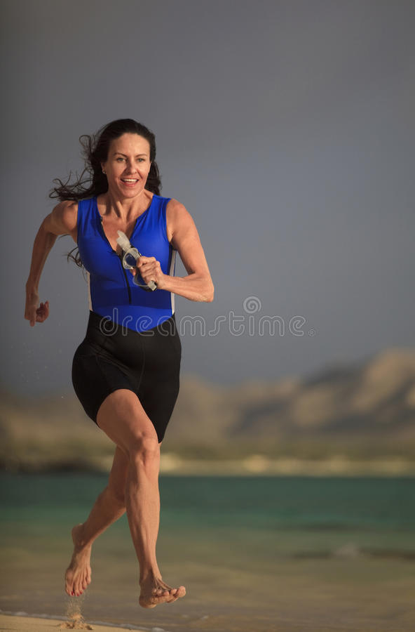 Download Forty Year Old Female Triathlete Running Stock Image - Image: 14074717