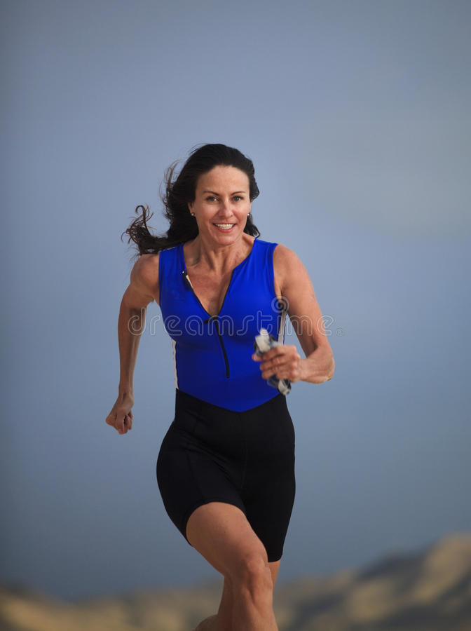 Download Forty Year Old Female Triathlete Running Stock Photo - Image: 14074730