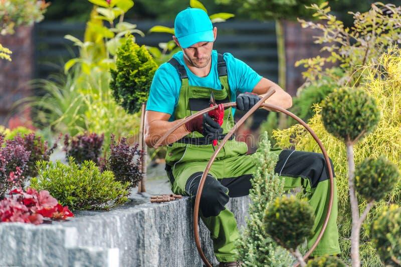 Men Building Garden Irrigation stock image
