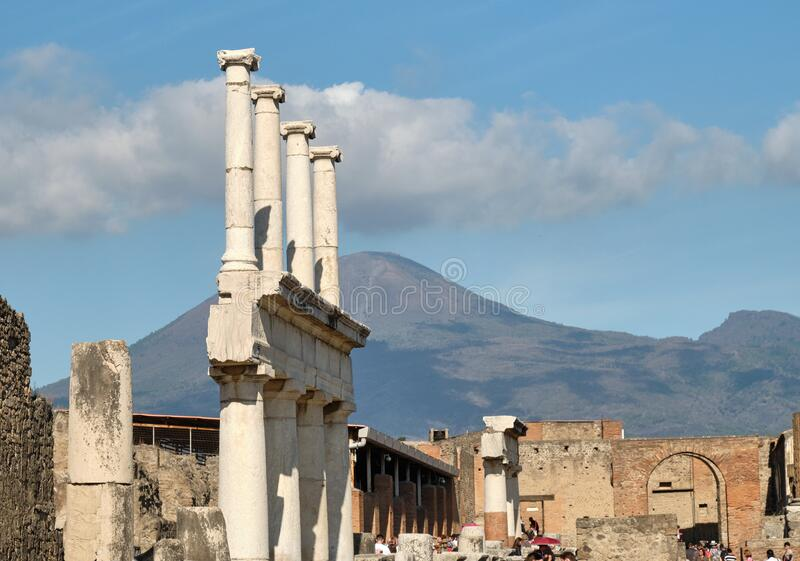 Forum columns and Mt Vesuvius. Remains of the colonnade in the Forum, Pompeii with Mt Vesuvius in the background royalty free stock images