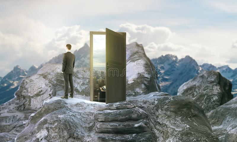Forward concept. Thoughtful young businessman next to mountain steps leading to abstract open door with view on sky background. Forward concept. 3D Rendering stock illustration