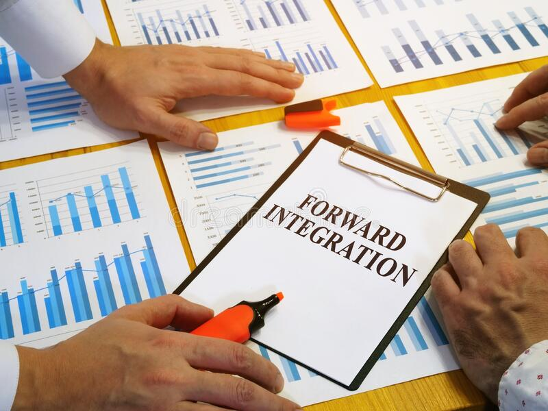 Forward integration plan as business strategy. Forward integration plan as business strategy and papers stock photo
