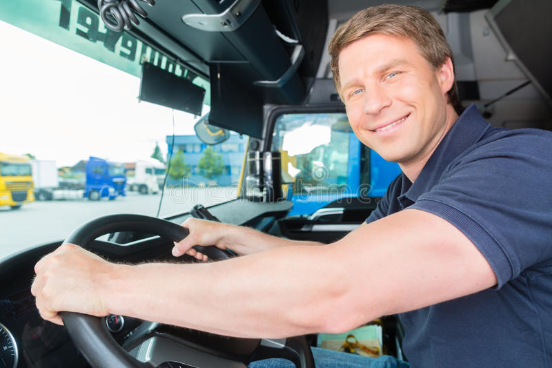 Forwarder or truck driver in drivers cap stock images