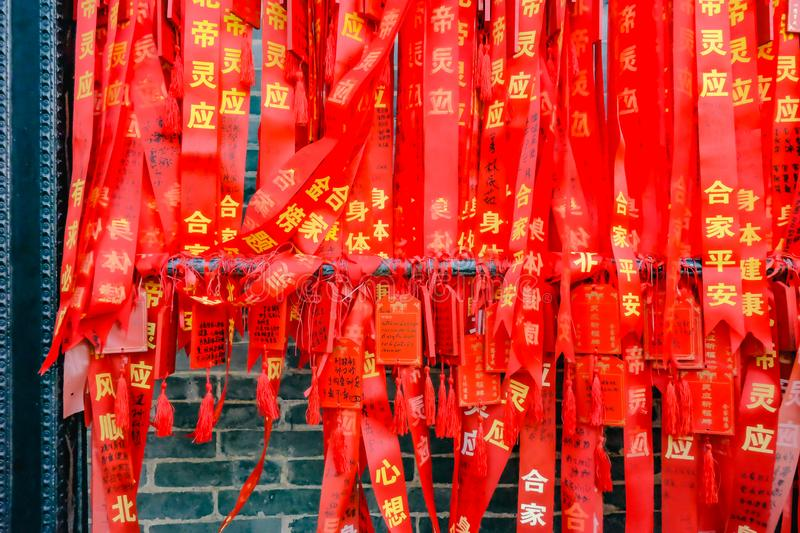 Colorful Red Blessing ribbon,Wish and message in Foshan Ancestral Temple or `Zumiao ` in chinese name.Foshan city china. Foshan/China - 27 November 2015:Colorful stock photography