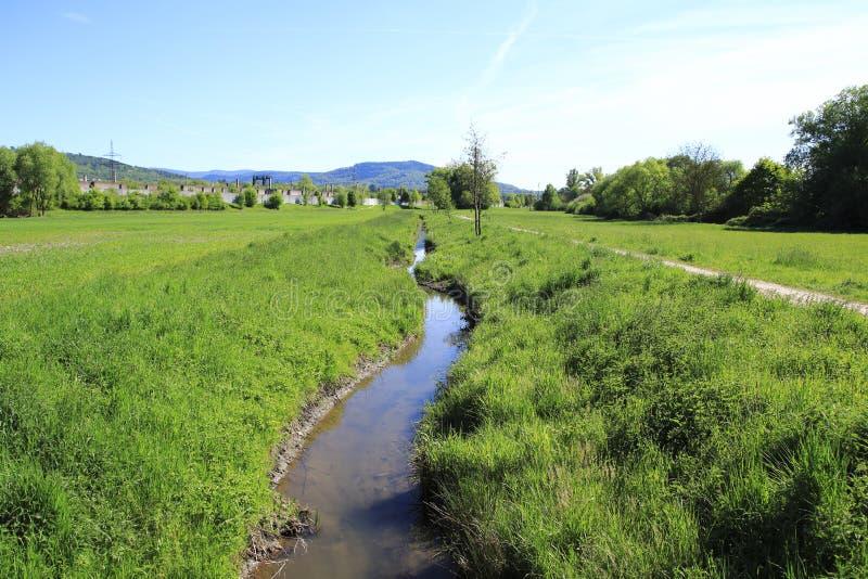 Fossa della terra di Ooser, fiume Sandweier di Landgraben ad un distretto di Baden-Baden fotografie stock